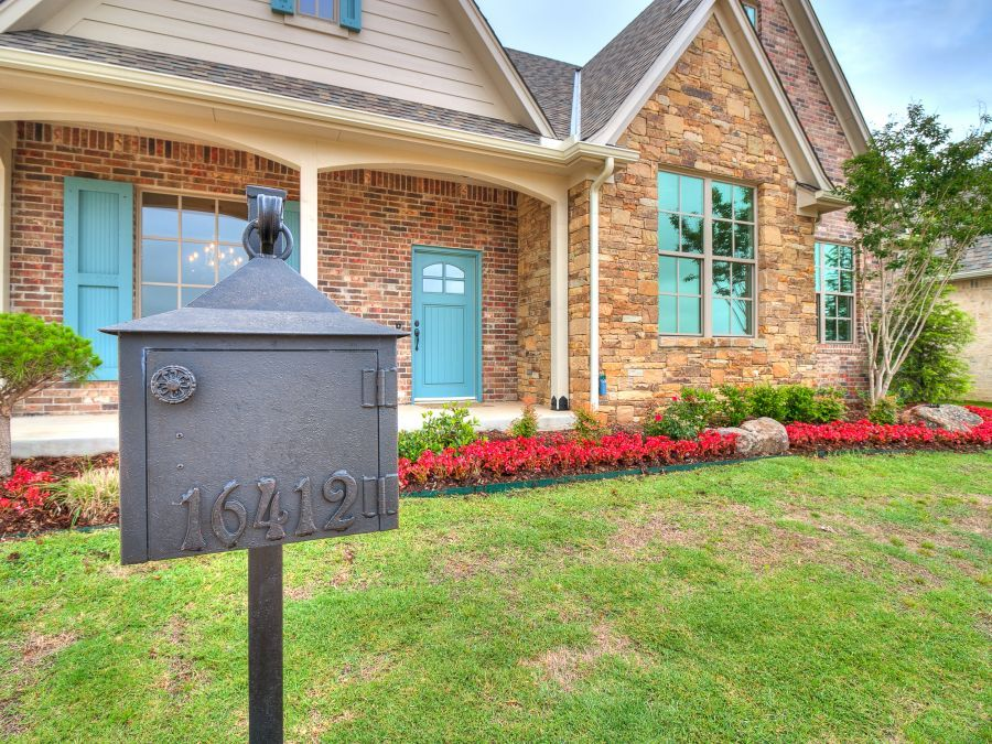 Close up of home and mailbox with address number.