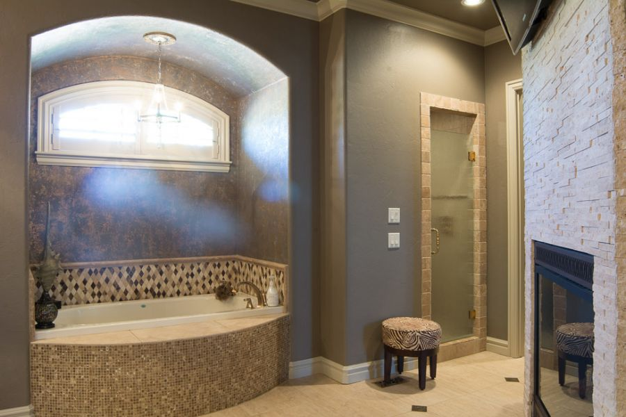 Master bathroom with tub, shower, fireplace, and tv.