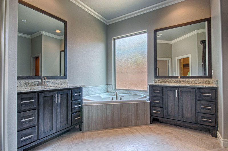 Master bathroom with his and her sink and tub.