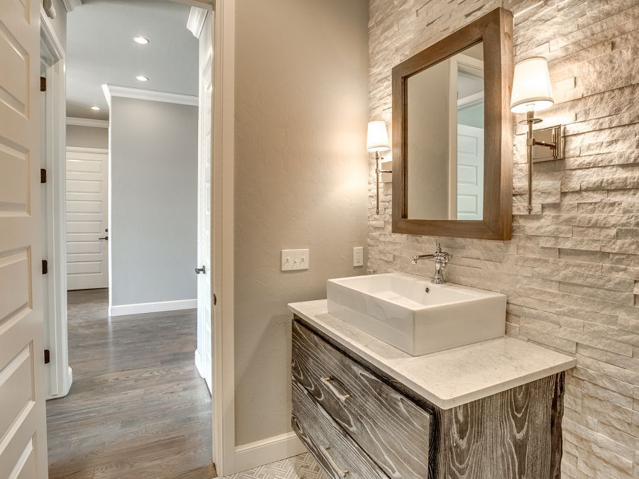 Powder room with beautiful tile wall.