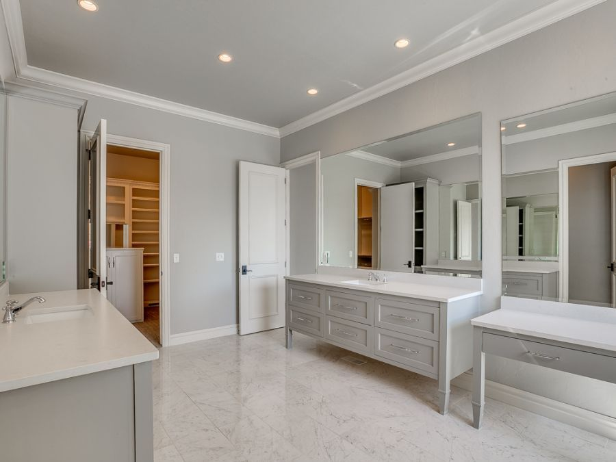 Master bathroom with his and her sink and a powder counter.
