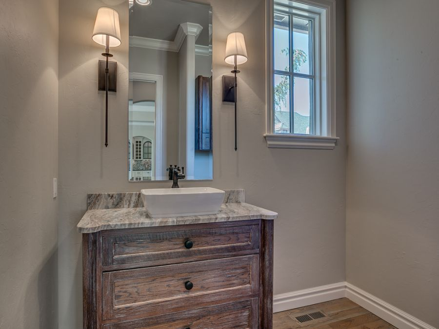 Powder room with rustic wood cabinets.