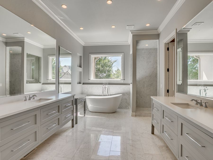Master bathroom with large counter space and beautiful marble tile.