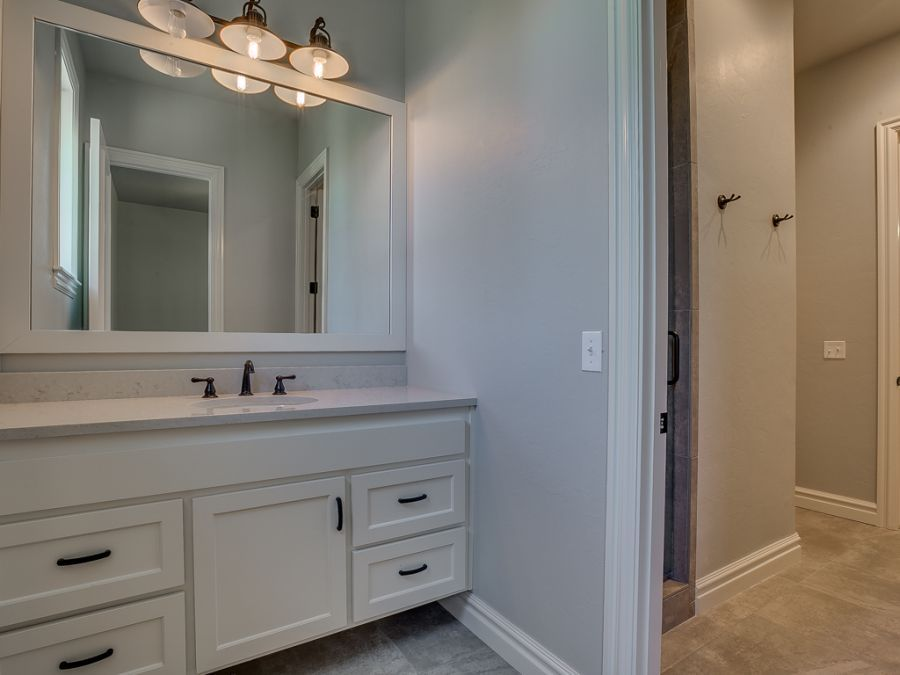 Guest bathroom with large mirror and counter space.