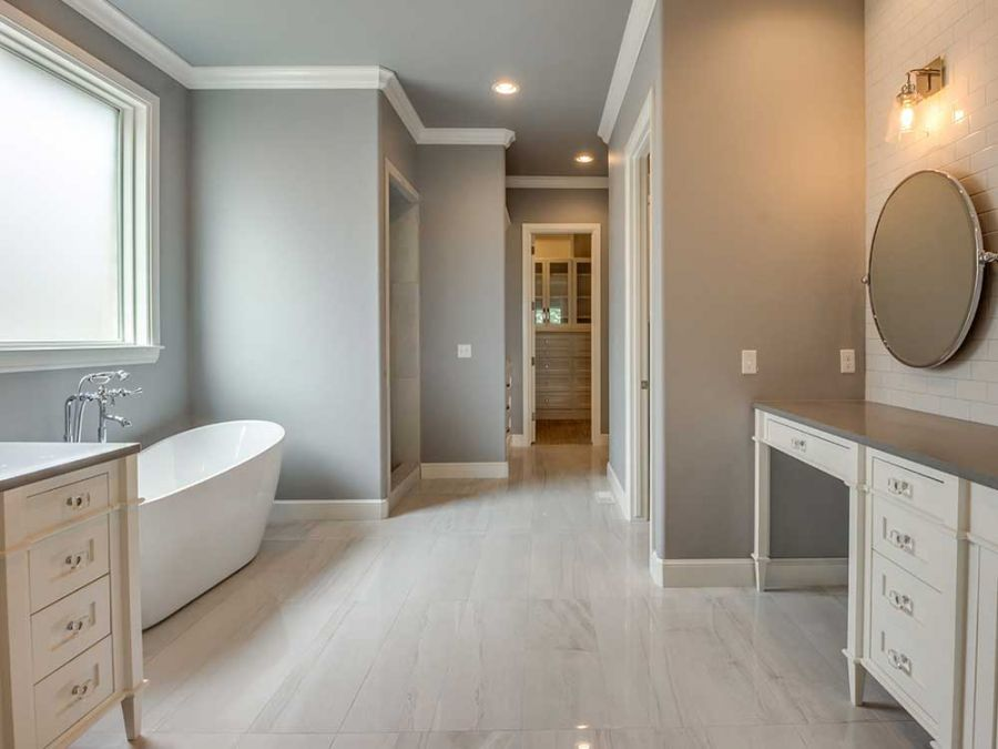 Luxurious master bathroom with beautiful tile walls and floor.