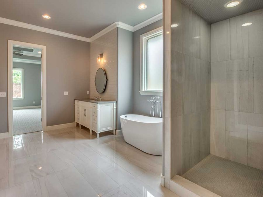 Large master shower with view to the entrance of the master bedroom.
