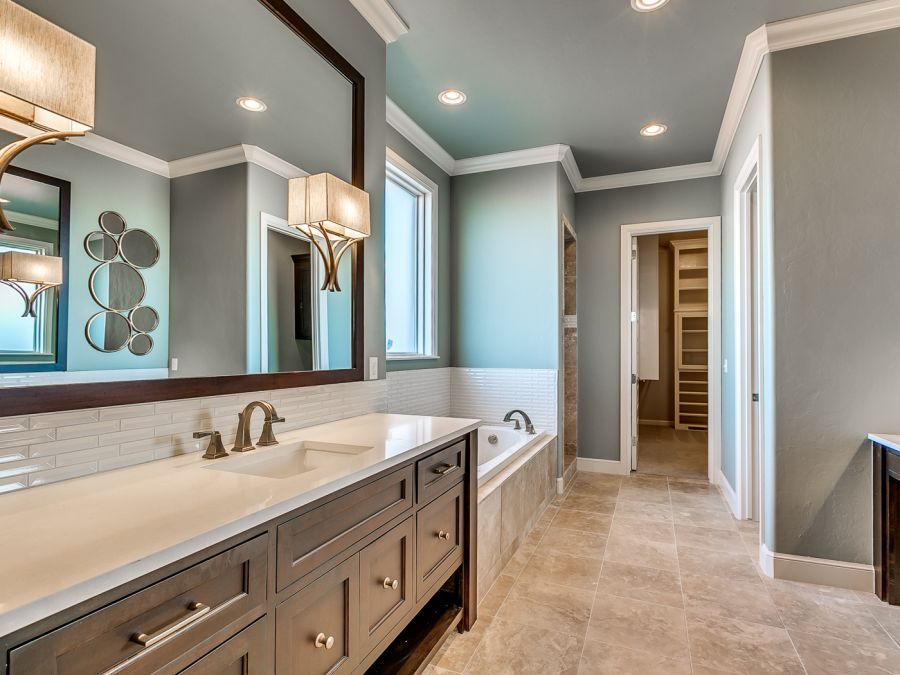 Eloquent master bathroom with his and her sink.