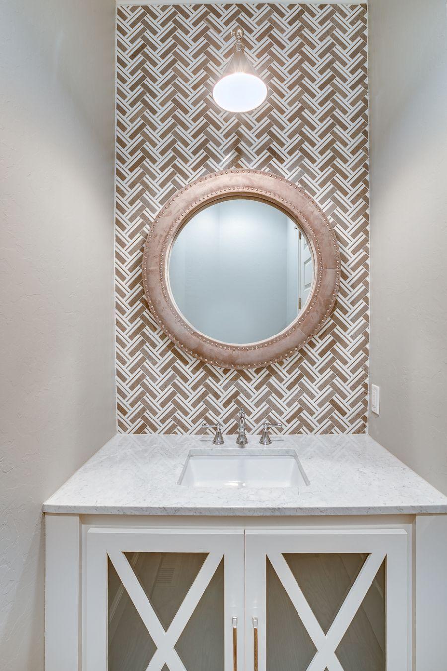 Powder room with gorgeous tile backsplash.