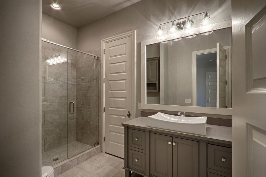Additional bathroom with large vanity and beautiful shower.