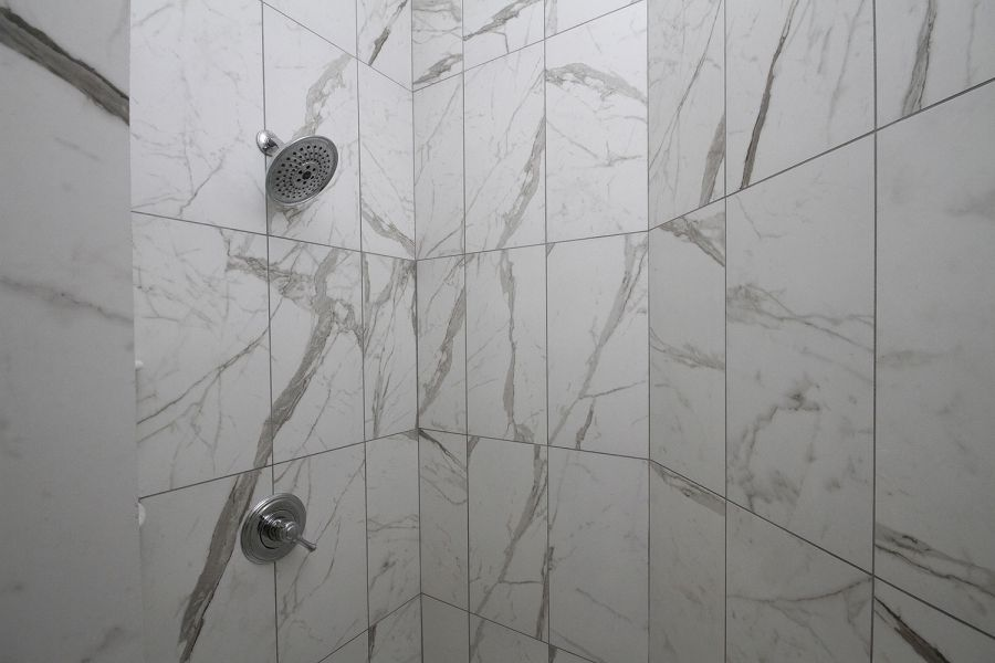 Master shower with luxurious large tiles.