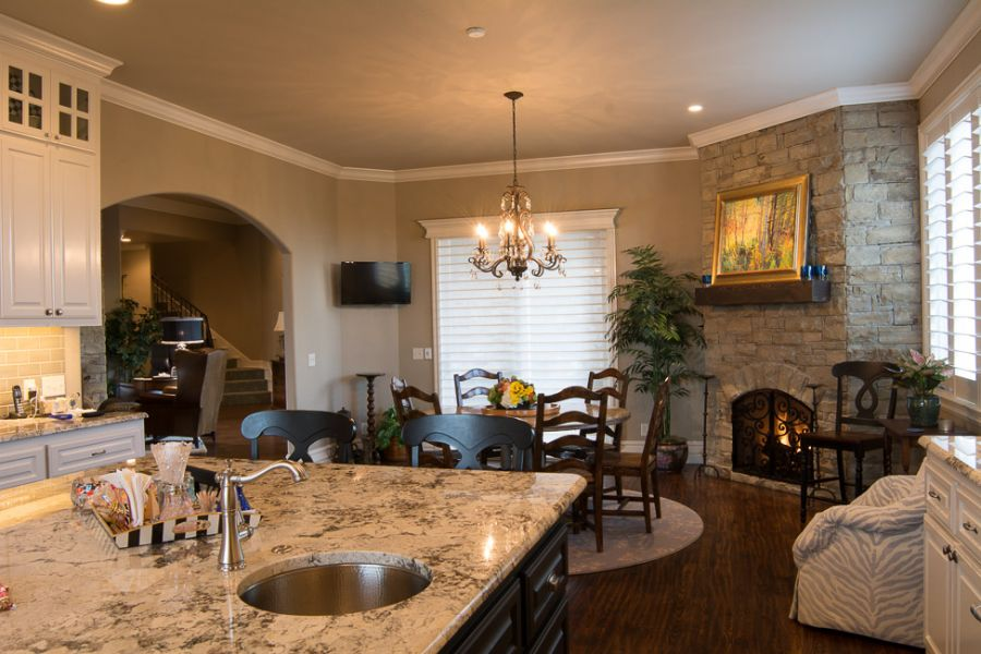 Perfect dining area right next to a real stone fireplace.