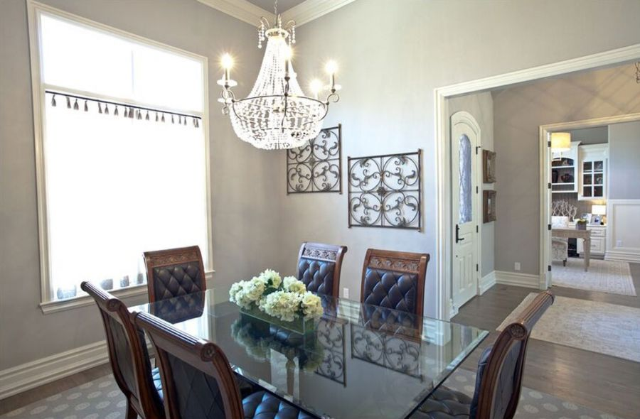 Dinning area with luxurious chandler above table area.
