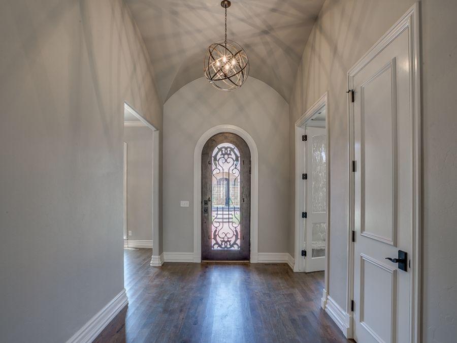 Beautiful entryway with ironwork on door.