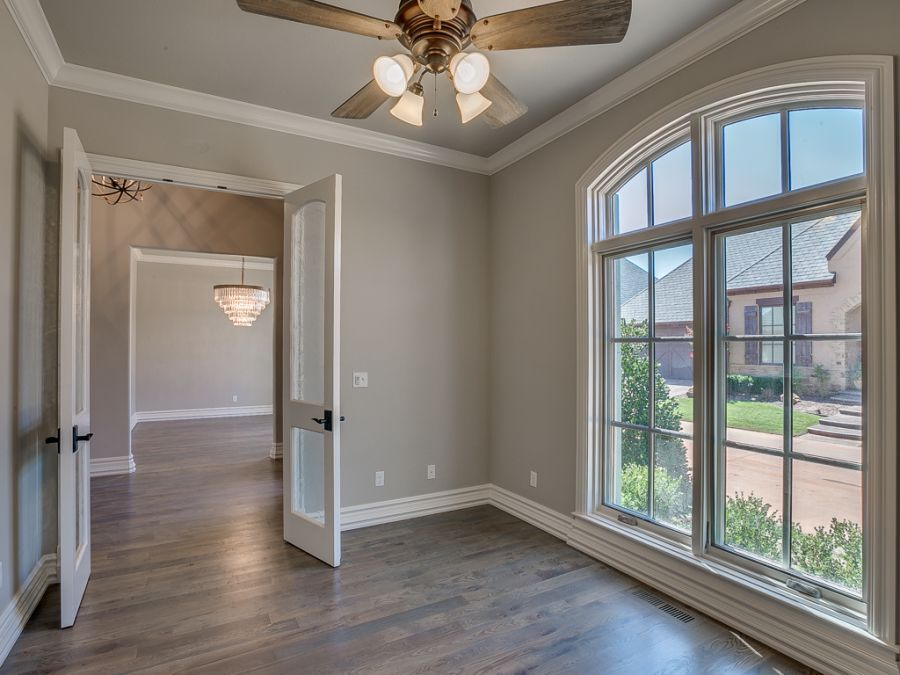 Entryway leading into study with large windows for natural lighting by Bill Roberts Custom Homes.