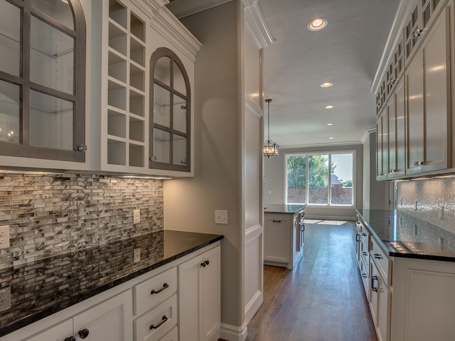 Eloquent look of grey and white cabinets in entryway.