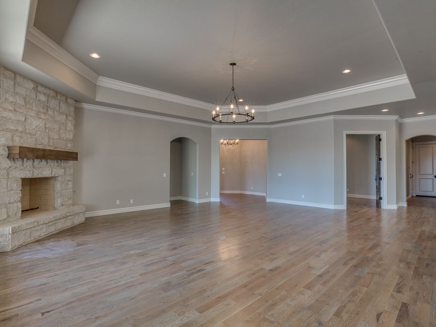 Entryway leading into the grand living room with real fireplace made of stone. Perfect for entertaining guest.