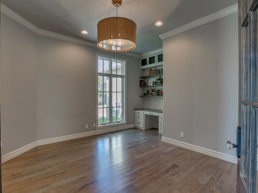 Entry hallway leading into large study room with natural lighting by Bill Roberts Custom Homes.
