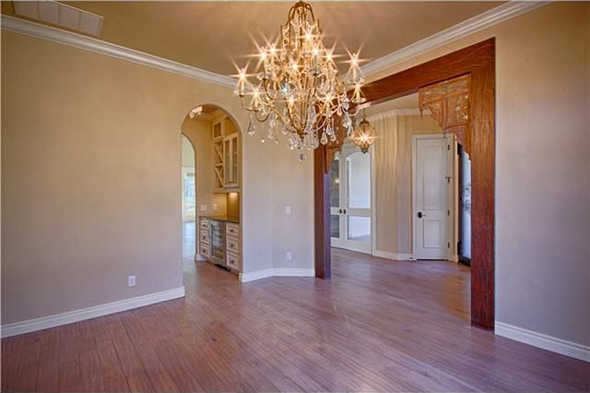 Entryway leading into hallway with beautiful woodwork.