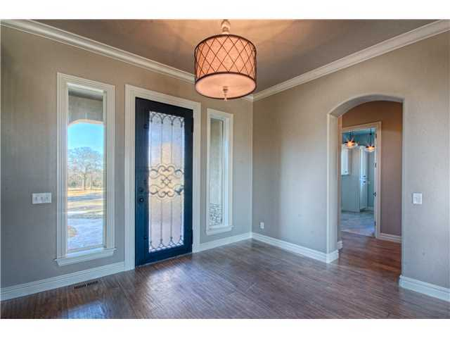 Beautiful entry with large windows for natural lighting by Bill Roberts Custom Homes.