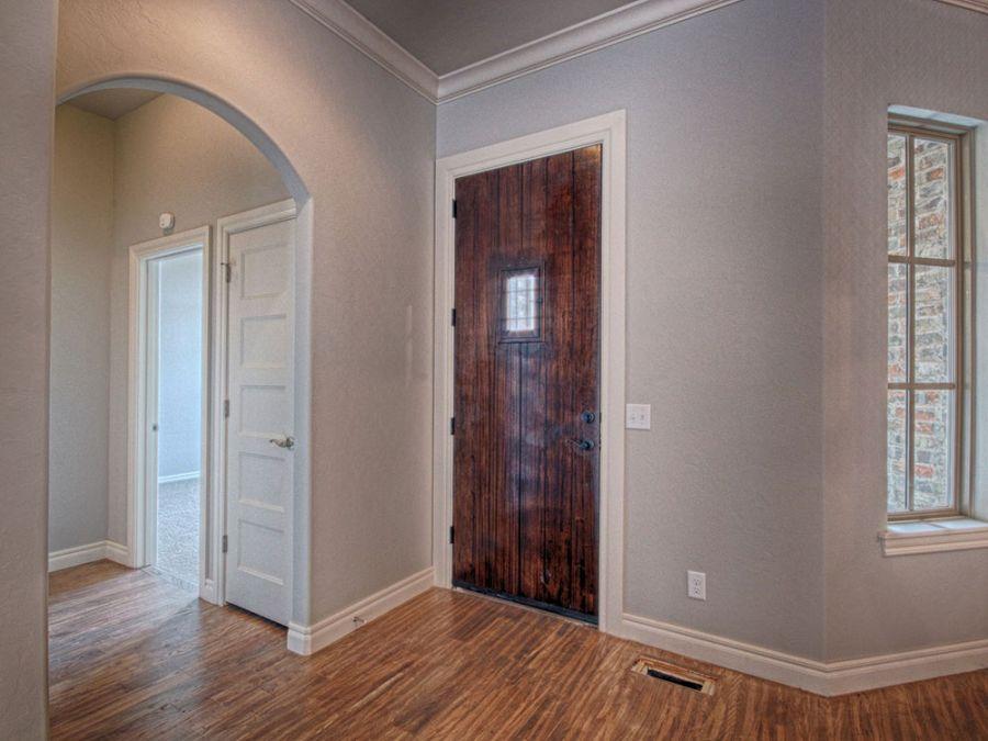 Rustic looking entry door made of dark wood.