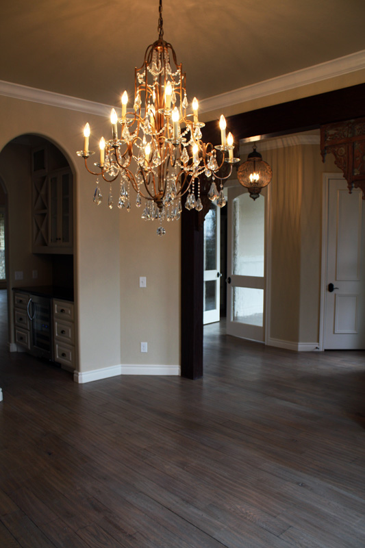 Elegant chandler in entry way of home by Bill Roberts Custom Homes