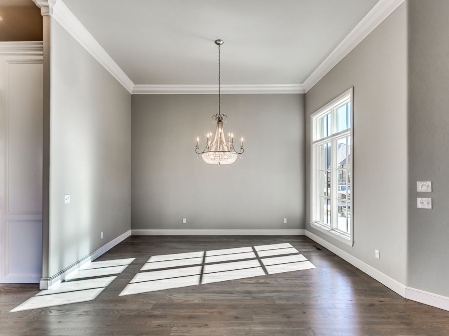 Entry Space with elegant chandler and large windows for natural lighting.