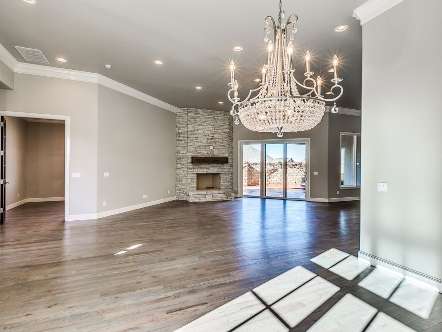 Large entry area leading to open floor plan design for living, dining and kitchen area.