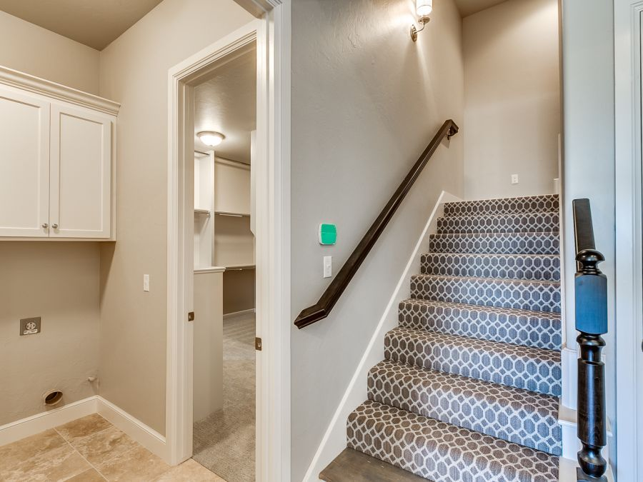 Entryway leading to stairs and laundry room by Bill Roberts Custom Homes.