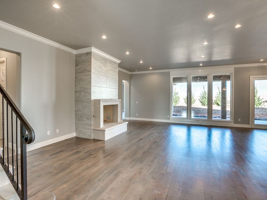 Entry way leading into living area with large fireplace for real fires. Wood flooring across the whole area