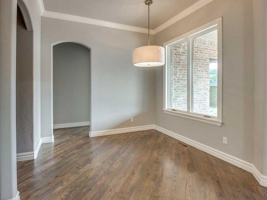 Spacious entry way with elegant wood flooring by Bill Roberts Custom Homes.