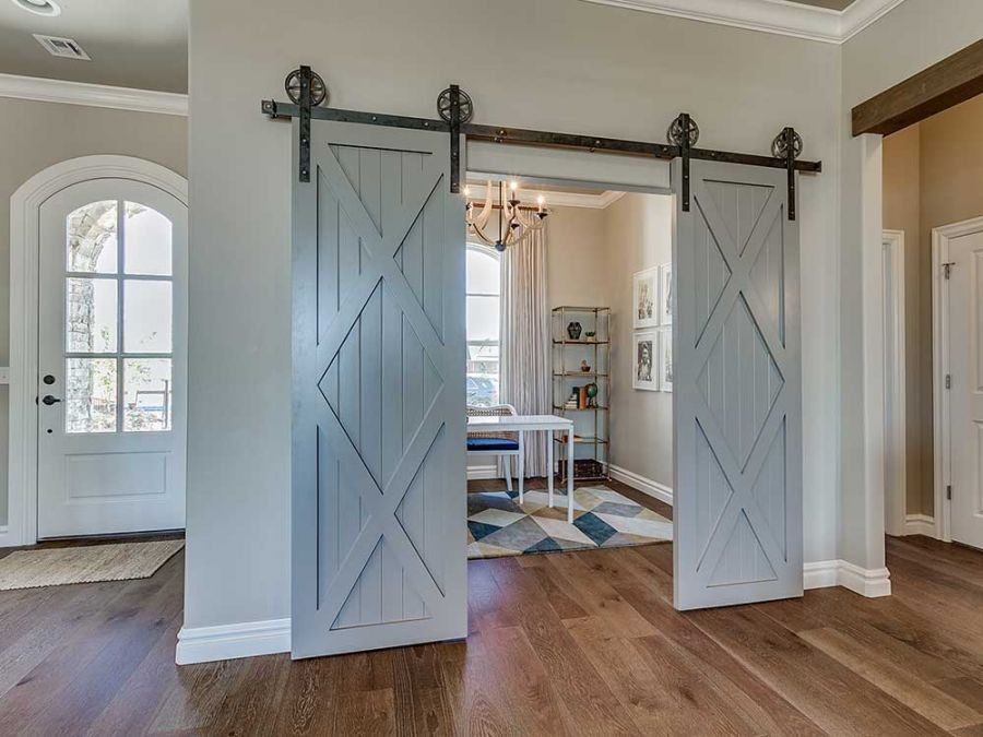 Entryway with study beside it. Beautiful sliding doors into study.