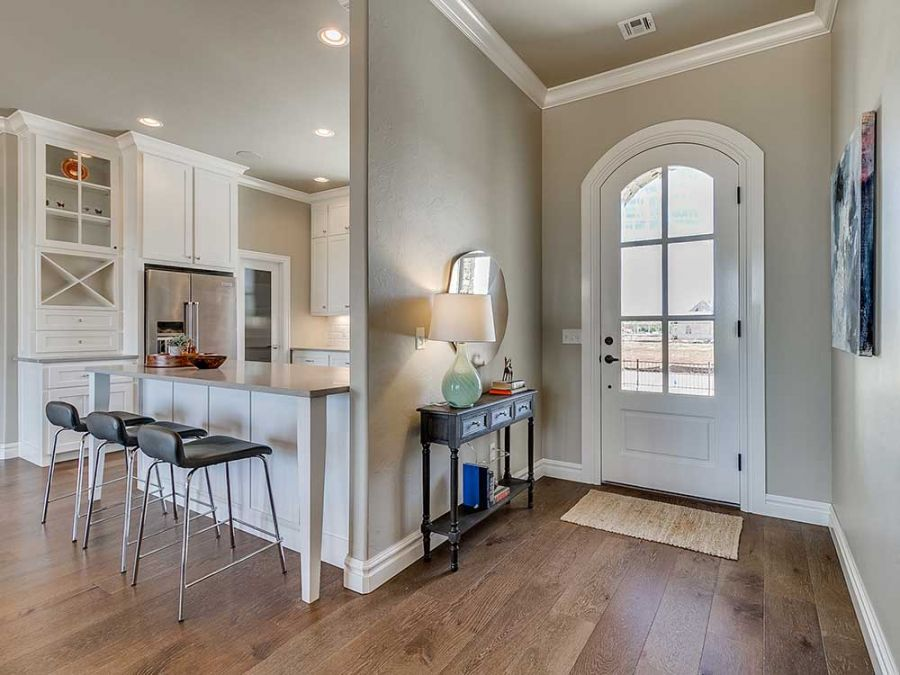 Beautiful entryway with large door and table beside it.