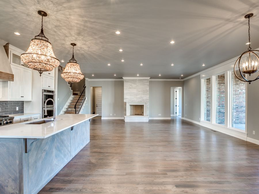 Dining area and Family room next to kitchen island with open floor design.