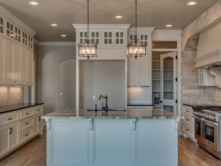 Front view of luxurious kitchen that has a classic rustic look.
