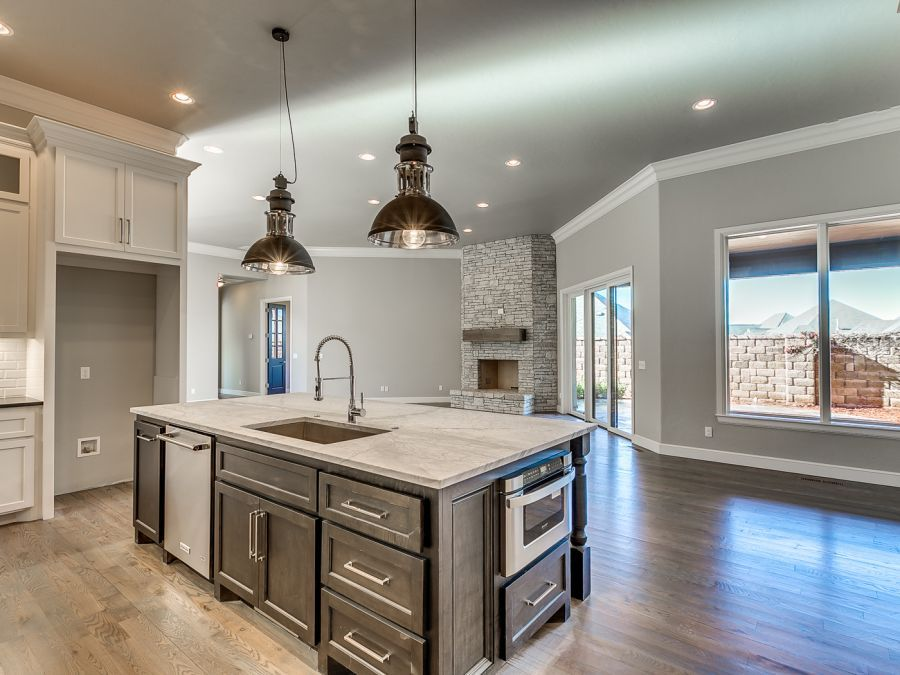 Gorgeous kitchen with full view of family area that has a real fireplace.