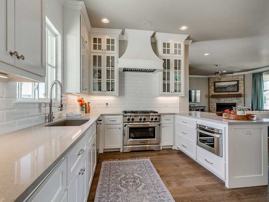 Beautiful white elegant kitchen with an L shaped island.