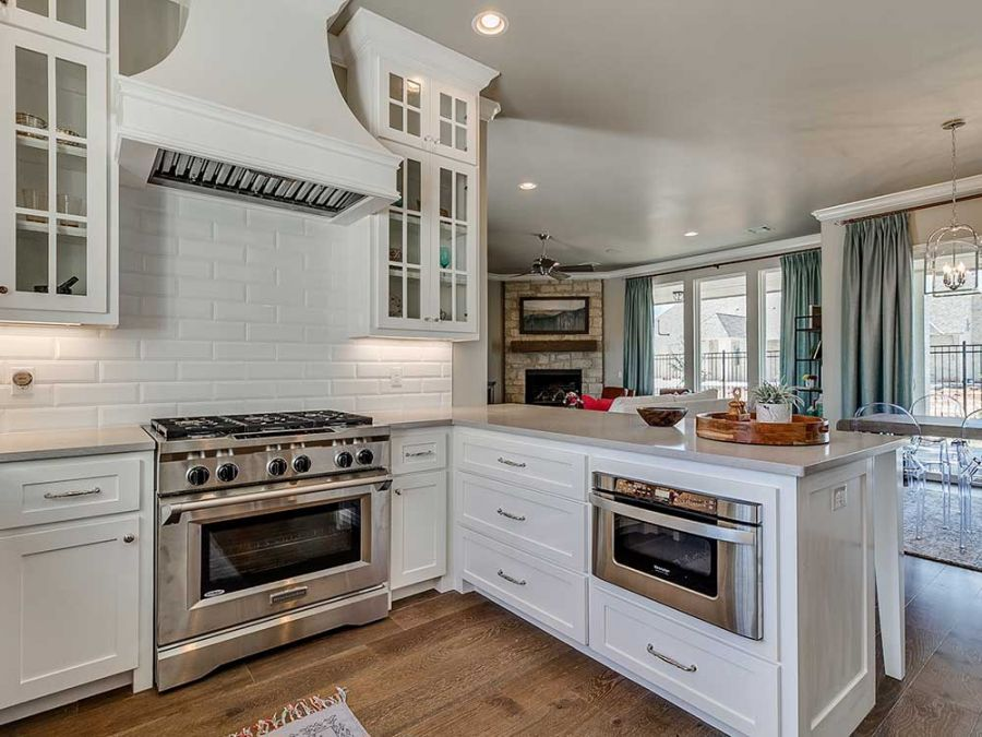 Large vent over stainless steel oven and stove with perfect amount of counter space.
