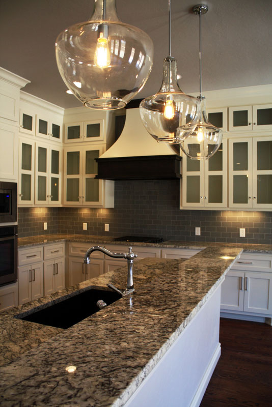 Gorgeous kitchen counters with black and cream design.