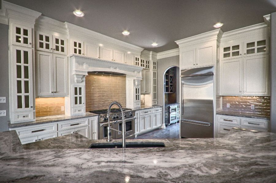 Full view of beautiful kitchen with gray and white counter tops.