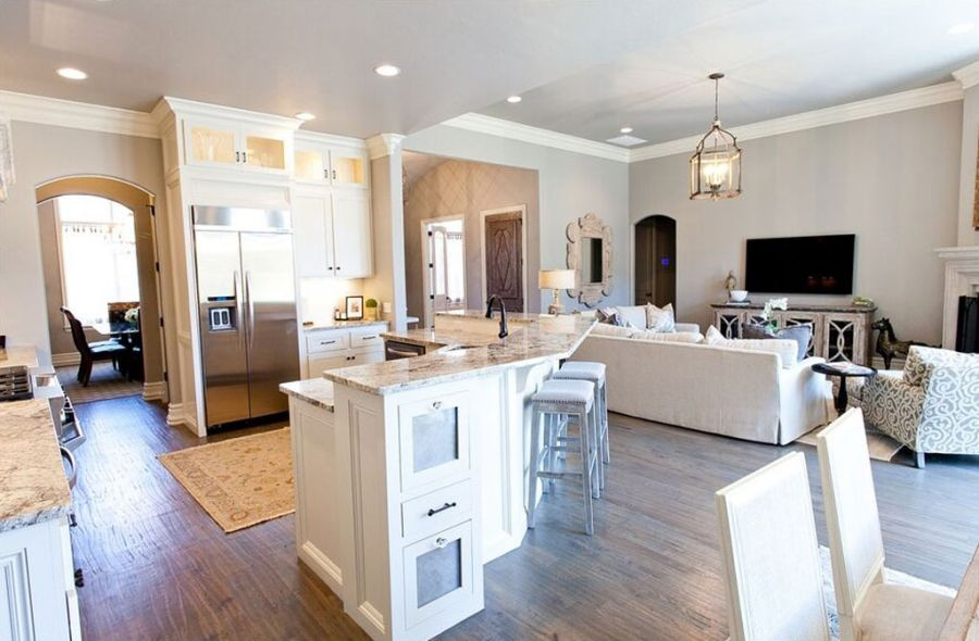Beautiful kitchen with white cabinets and light kitchen counter tops.