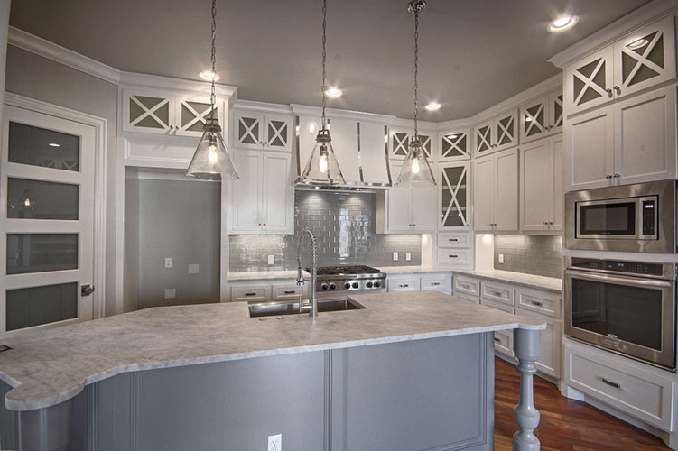 Luxurious kitchen with gray and white color scheme.