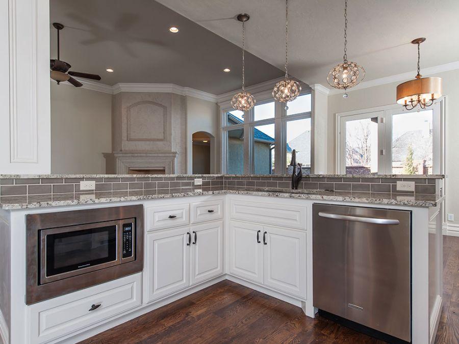 Beautiful kitchen with L shaped island.