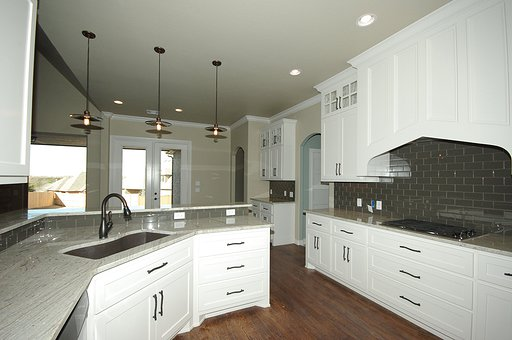 Cornered Island with beautiful white cabinets underneath.