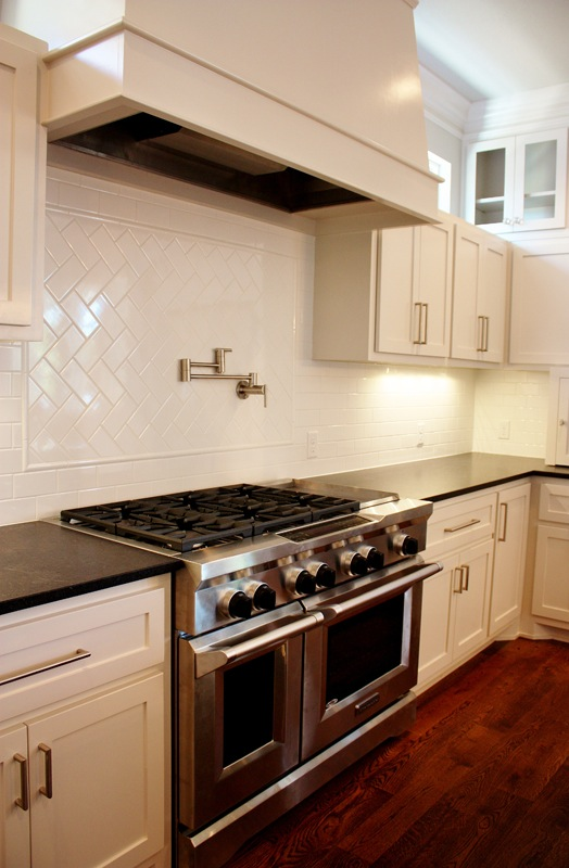 State of the art kitchen with stainless steel oven and gas stove with plenty of counter space.