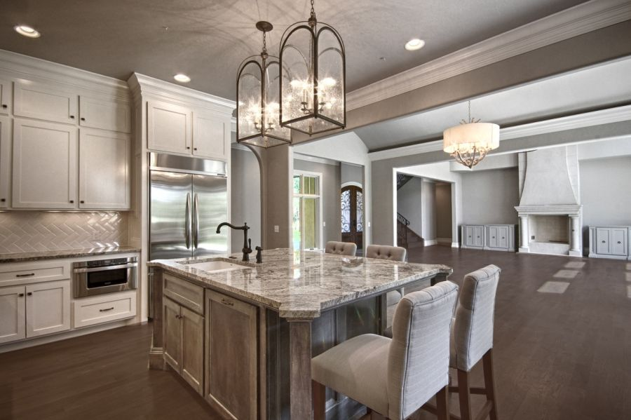 Elegant kitchen with perfect chandlers above island.