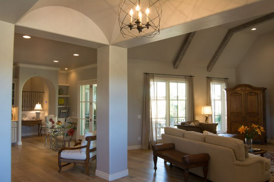 Living area with large wood beams patio door entrance.