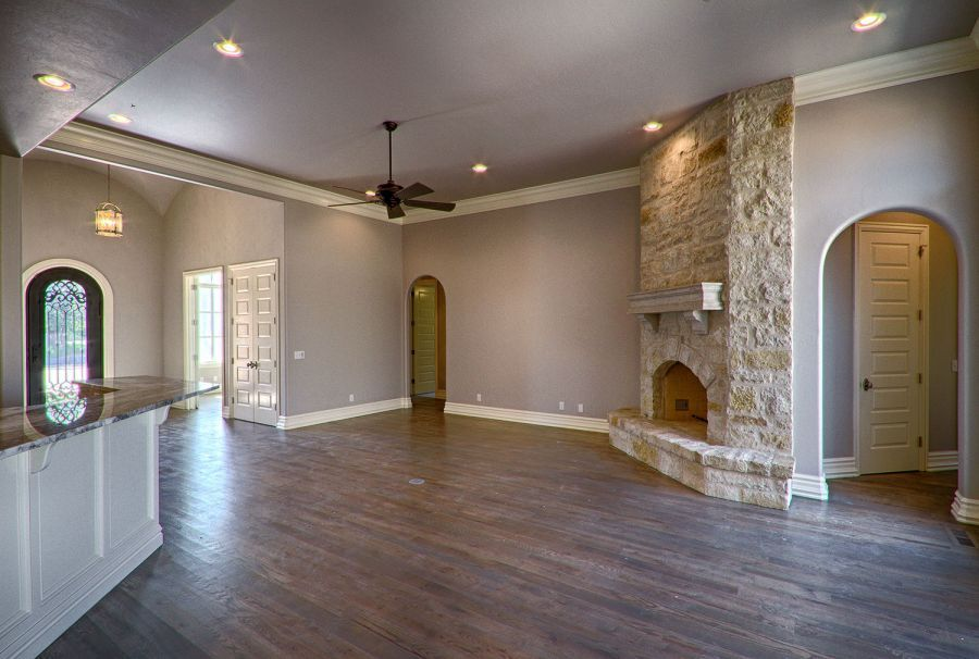 Stone fireplace in living area near front entrance and back patio.