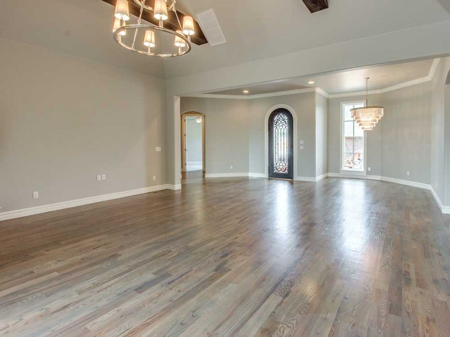 Beautiful Living Room with wood tresses, chandler, and wood flooring with plenty of natural lighting.