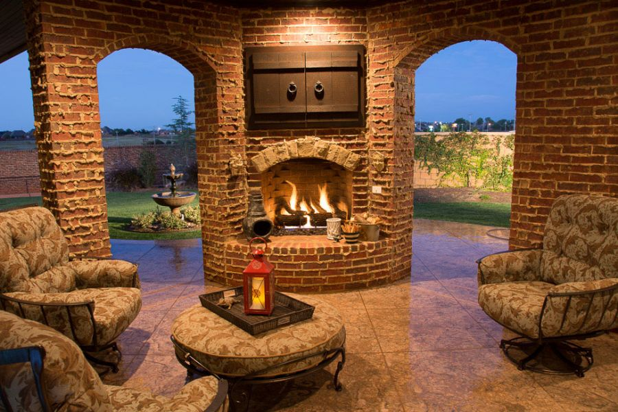 Completely covered and luxurious outdoor living area with fireplace.